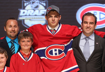 PITTSBURGH, PA - JUNE 22:  Alex Galchenyuk (3rd R), third overall pick by the Montreal Canadiens, poses on stage with Canadiens representatives during Round One of the 2012 NHL Entry Draft at Consol Energy Center on June 22, 2012 in Pittsburgh, Pennsylvan