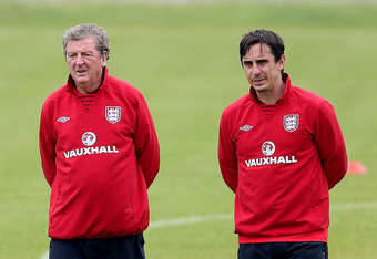 KRAKOW, POLAND - JUNE 22:  England manager Roy Hodgson with Gary Neville (R) during an England training session ahead of their UEFA EURO 2012 quarter final match with Italy on June 22, 2012 in Krakow, Poland.  (Photo by Scott Heavey/Getty Images)