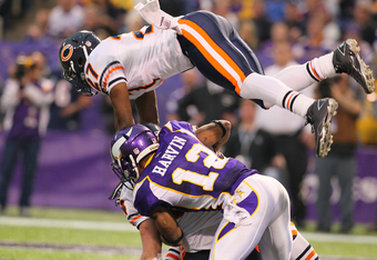 MINNEAPOLIS, MN - JANUARY 01:   Major Wright #27 of the Chicago Bears goes flying over Percy Harvin #12 of the Minnesota Vikings and Brian Urlacher #54 of the Chicago Bears at the Hubert H. Humphrey Metrodome on January 01, 2012 in Minneapolis, Minnesota.