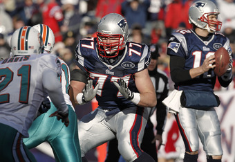 FOXBORO, MA - DECEMBER 24: Nate Solder #77 of the New England Patriots blocks against the Miami Dolphins  during the first quarter at Gillette Stadium on December 24, 2011 in Foxboro, Massachusetts.  (Photo by Winslow Townson/Getty Images)