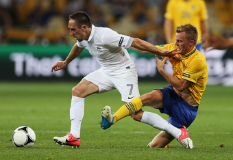 KIEV, UKRAINE - JUNE 19:  Franck Ribery of France is tackled by Sebastian Larsson of Sweden during the UEFA EURO 2012 group D match between Sweden and France at The Olympic Stadium on June 19, 2012 in Kiev, Ukraine.  (Photo by Julian Finney/Getty Images)