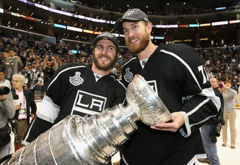 LOS ANGELES, CA - JUNE 11:  Mike Richards #10 and Jeff Carter #77 of the Los Angeles Kings hold the Stanley Cup in celebration after defeating the New Jersey Devils in Game Six of the 2012 Stanley Cup Finals at Staples Center on June 11, 2012 in Los Angel