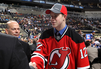 PITTSBURGH, PA - JUNE 23: Damon Severson, 60th overall pick by the New Jersey Devils, shakes hands  during day two of the 2012 NHL Entry Draft at Consol Energy Center on June 23, 2012 in Pittsburgh, Pennsylvania.  (Photo by Bruce Bennett/Getty Images)