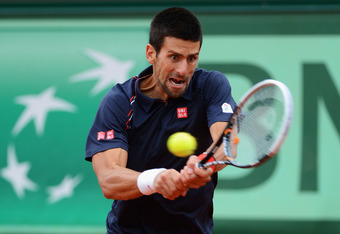 PARIS, FRANCE - JUNE 11:  Novak Djokovic of Serbia plays a backhand during the men's singles final against Rafael Nadal of Spain on day 16 of the French Open at Roland Garros on June 11, 2012 in Paris, France.  (Photo by Mike Hewitt/Getty Images)