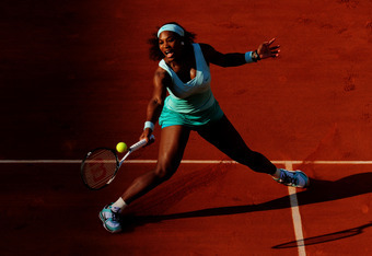 PARIS, FRANCE - MAY 29:  Serena Williams of USA plays a forehand in her women's singles first round match between Serena Williams of USA and Virginie Razzano of France during day three of the French Open at Roland Garros on May 29, 2012 in Paris, France.