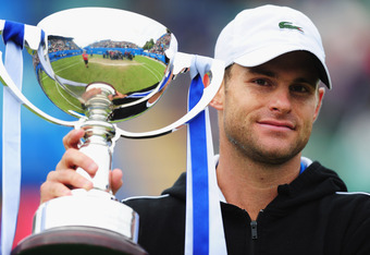EASTBOURNE, ENGLAND - JUNE 23:  Andy Roddick of USA holds aloft the winner's trophy after defeating Andreas Seppi of Italy in the Men's Final during the AEGON International at Devonshire Park  on June 23, 2012 in Eastbourne, England.  (Photo by Mike Hewit