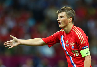 WARSAW, POLAND - JUNE 16:  Andrey Arshavin of Russia in action during the UEFA EURO 2012 group A match between Greece and Russia at The National Stadium on June 16, 2012 in Warsaw, Poland.  (Photo by Shaun Botterill/Getty Images)