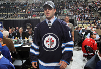 PITTSBURGH, PA - JUNE 23:  Lukas Sutter, 39th overall pick by the Winnipeg Jets, walks on the draft floor during day two of the 2012 NHL Entry Draft at Consol Energy Center on June 23, 2012 in Pittsburgh, Pennsylvania.  (Photo by Bruce Bennett/Getty Image