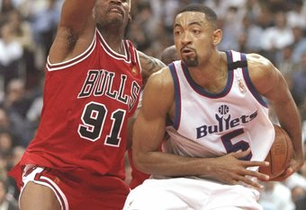 30 Apr 1997:  Forward Juwan Howard of the Washington Bullets drives to the basket as forward Dennis Rodman of the Chicago Bulls guards him during a playoff game at the US Air Arena in Landover, Maryland.  The Bulls won the game 96-95. Mandatory Credit: Do