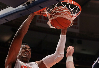 NEW YORK, NY - MARCH 08:  Fab Melo #51 of the Syracuse Orange dunks against the Connecticut Huskies during the quarterfinals of the Big East Men's Basketball Tournament at Madison Square Garden on March 8, 2012 in New York City.  (Photo by Jim McIsaac/Get