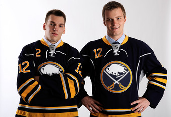 PITTSBURGH, PA - JUNE 22:  Mikhail Grigorenko (L), drafted 12th overall by the Buffalo Sabres, and Zemgus Girgensons (R), drafted 14th overall by the Buffalo Sabres, pose for a portrait during Round One of the 2012 NHL Entry Draft at Consol Energy Center