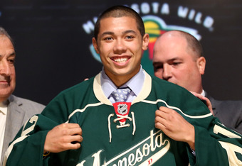 PITTSBURGH, PA - JUNE 22:  Mathew Dumba, seventh overall pick by the Minnesota Wild, poses on stage during Round One of the 2012 NHL Entry Draft at Consol Energy Center on June 22, 2012 in Pittsburgh, Pennsylvania.  (Photo by Bruce Bennett/Getty Images)