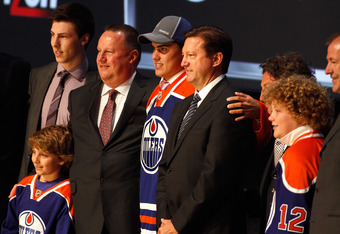 PITTSBURGH, PA - JUNE 22:  Nail Yakupov (C), first overall pick by the Edmonton Oilers, poses onstage with Ryan Nugent-Hopkins (L) of the Oilers and Oilers team representatives during Round One of the 2012 NHL Entry Draft at Consol Energy Center on June 2