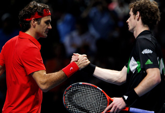 LONDON, ENGLAND - NOVEMBER 23:  Roger Federer (L) of Switzerland shakes hands with Andy Murray of Great Britain after winning his men's singles match during the ATP World Tour Finals at O2 Arena on November 23, 2010 in London, England.  (Photo by Clive Br