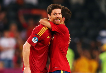 DONETSK, UKRAINE - JUNE 23:  Xabi Alonso of Spain celebrates with Jordi Alba during the UEFA EURO 2012 quarter final match between Spain and France at Donbass Arena on June 23, 2012 in Donetsk, Ukraine.  (Photo by Alex Livesey/Getty Images)