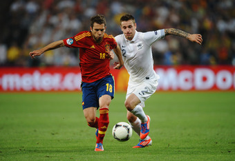 DONETSK, UKRAINE - JUNE 23: Jordi Alba of Spain and Mathieu Debuchy of France challenge for the ball during the UEFA EURO 2012 quarter final match between Spain and France at Donbass Arena on June 23, 2012 in Donetsk, Ukraine.  (Photo by Laurence Griffith