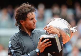 PARIS, FRANCE - JUNE 11:  Rafael Nadal of Spain poses with the Coupe des Mousquetaires trophy in the men's singles final against Novak Djokovic of Serbia during day 16 of the French Open at Roland Garros on June 11, 2012 in Paris, France.  (Photo by Mike