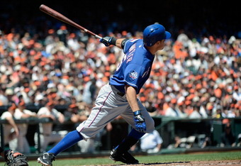 SAN FRANCISCO, CA - JUNE 10:  Ian Kinsler #5 of the Texas Rangers hits a bases loaded double driving in two runs in the fourth inning against the San Francisco Giants at AT&T Park on June 10, 2012 in San Francisco, California.  (Photo by Thearon W. Hender