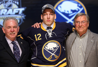 PITTSBURGH, PA - JUNE 22:  Zemgus Girgensons (C), 14th overall pick by the Buffalo Sabres, poses with Sabres representatives on stage during Round One of the 2012 NHL Entry Draft at Consol Energy Center on June 22, 2012 in Pittsburgh, Pennsylvania.  (Phot