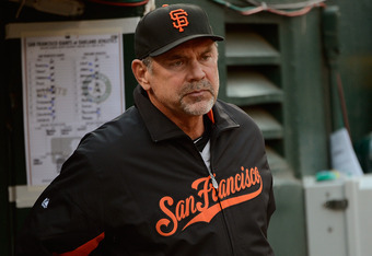 OAKLAND, CA - JUNE 22: Manager Bruce Bochy #15 of the San Francisco Giants looks on from the dugout in the first inning against the Oakland Athletics at O.co Coliseum on June 22, 2012 in Oakland, California.  (Photo by Thearon W. Henderson/Getty Images)