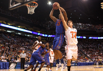 PHOENIX, AZ - MARCH 24:  Bradley Beal #23 of the Florida Gators grabs the ball alongside Kyle Kuric #14 of the Louisville Cardinals in the second half during the 2012 NCAA Men's Basketball West Regional Final at US Airways Center on March 24, 2012 in Phoe