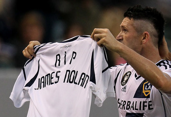 CARSON, CA - JUNE 23:  Robbie Keane #7 of the Los Angeles Galaxy holds up a jersey with 'RIP James Nolan' printed on the back in honor of a 21 year old Irish soccer fan who drowned in Poland while attending Euro 2012 after Keane scored a first half goal a