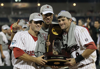 OMAHA, NE - JUNE 28:  (L-R) Brady Thomas #36, Michael Roth #29 and Scott Wingo #8 of the South Carolina Gamecocks celebrate with the trophy after winning the men's 2011 NCAA College Baseball World Series at TD Ameritrade Park Omaha on June 28, 2011 in Oma