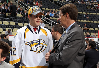 PITTSBURGH, PA - JUNE 23:  Pontus Aberg, 37th overall pick by the Nashville Predators, speaks to Predators General Manager David Poile during day two of the 2012 NHL Entry Draft at Consol Energy Center on June 23, 2012 in Pittsburgh, Pennsylvania.  (Photo