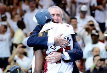 MIAMI, FL - JUNE 21:  Team President Pat Riley of the Miami Heat hugs Mario Chalmers #15 as they celebrate after their 121-106 win against the Oklahoma City Thunder in Game Five of the 2012 NBA Finals on June 21, 2012 at American Airlines Arena in Miami,
