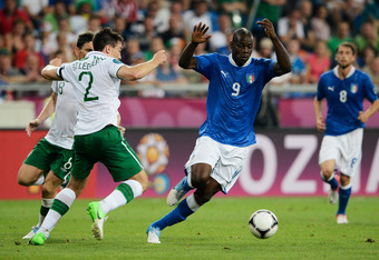 POZNAN, POLAND - JUNE 18:  Mario Balotelli of Italy attempts to evade the challenge by Sean St Ledger of Republic of Ireland during the UEFA EURO 2012 group C match between Italy and Ireland at The Municipal Stadium on June 18, 2012 in Poznan, Poland.  (P