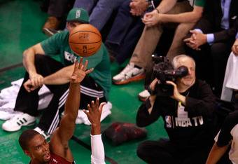 BOSTON, MA - JUNE 07:  Chris Bosh #1 of the Miami Heat attempts a shot against Ray Allen #20 of the Boston Celtics in Game Six of the Eastern Conference Finals in the 2012 NBA Playoffs on June 7, 2012 at TD Garden in Boston, Massachusetts. NOTE TO USER: U