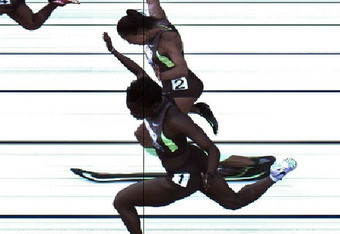 EUGENE, OR - JUNE 23:  In this handout photo provided by the USTF, Jeneba Tarmoh (bottom, lane 1) and Allyson Felix cross the finish line at exactly the same time in the women's 100 meter dash final during Day Two of the 2012 U.S. Olympic Track & Field Te