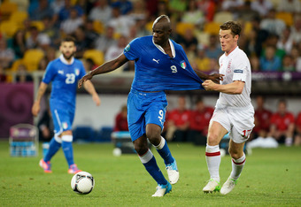 KIEV, UKRAINE - JUNE 24: Mario Balotelli of Italy and Scott Parker of England in action during the UEFA EURO 2012 quarter final match between England and Italy at The Olympic Stadium on June 24, 2012 in Kiev, Ukraine.  (Photo by Claudio Villa/Getty Images