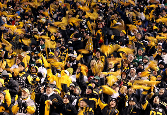 PITTSBURGH, PA - JANUARY 23:  Pittsburgh Steelers fans wave terrible towels during their 2011 AFC Championship game against the New York Jets at Heinz Field on January 23, 2011 in Pittsburgh, Pennsylvania.  (Photo by Al Bello/Getty Images)