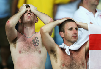 KIEV, UKRAINE - JUNE 24:  England fans look dejected after the penalty shoot out during the UEFA EURO 2012 quarter final match between England and Italy at The Olympic Stadium on June 24, 2012 in Kiev, Ukraine.  (Photo by Scott Heavey/Getty Images)