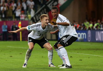 Marco Reus (left) and Jerome Boateng (right) of Germany celebrate.
