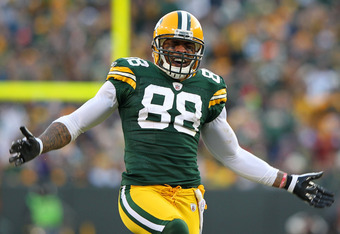 GREEN BAY, WI - JANUARY 15:   Jermichael Finley #88 of the Green Bay Packers reacts after a play against the New York Giants during their NFC Divisional playoff game at Lambeau Field on January 15, 2012 in Green Bay, Wisconsin.  (Photo by Jamie Squire/Get