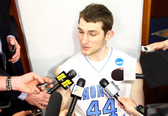 ST LOUIS, MO - MARCH 25:  (EDITORS NOTE: Image has been converted to black and white.) Tyler Zeller #44 of the North Carolina Tar Heels looks dejected in the locker room as he answers questions from the media after they lost 80-67 against the Kansas Jayha