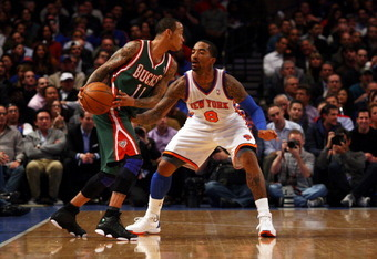 NEW YORK, NY - MARCH 26:  J.R. Smith #8 of the New York Knicks defends against Monta Ellis #11 of the Milwaukee Bucks at Madison Square Garden on March 26, 2012 in New York City. NOTE TO USER: User expressly acknowledges and agrees that, by downloading an