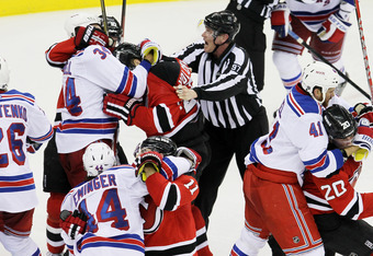 NEWARK, NJ - MAY 21:  Steve Eminger #44 of the New York Rangers, Stephen Gionta #11 of the New Jersey Devils, Ruslan Fedotenko #26, John Mitchell #34 and Stu Bickel #41 of the New York Rangers fight in Game Four of the Eastern Conference Final during the