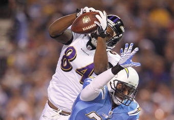 SAN DIEGO, CA - DECEMBER 18:  Ed Dickson #84 of the Baltimore Ravens scores a touchdown against Steve Gregory #28 of the San Diego Chargers at Qualcomm Stadium on December 18, 2011 in San Diego, California.  (Photo by Jeff Gross/Getty Images)