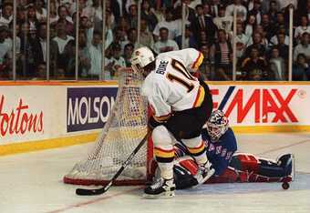 7 JUN 1994: RANGERS GOALTENDER MIKE RICHTER STONES CANUCK''S PAVEL BURE DURING A PENALTY SHOT TONIGHT DURING THE SECOND PERIOD OF GAME FOUR OF THE STANLEY CUP FINALS AT THE PACIFIC COLISEUM IN VANCOUVER, BRITISH COLUMBIA.  Mandatory Credit: Mike Powell/AL