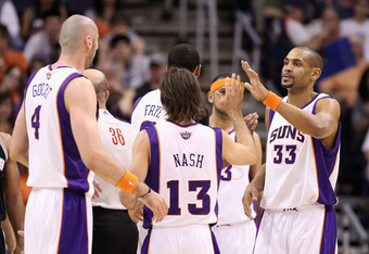 PHOENIX, AZ - APRIL 13:  Grant Hill #33 of the Phoenix Suns high fives teammates Steve Nash #13 and Marcin Gortat #4 after scoring against the San Antonio Spurs during the NBA game at US Airways Center on April 13, 2011 in Phoenix, Arizona.  NOTE TO USER: