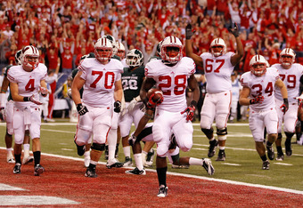 Montee Ball (center) scores one of his 39 touchdowns in 2011 for the Badgers.