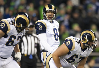 SEATTLE, WA - DECEMBER 12:  Sam Bradford #8 of the St. Louis Rams walks to the line during a game against the Seattle Seahawks at CenturyLink Field December 12, 2011 in Seattle, Washington. Seattle won 33-13. (Photo by Jay Drowns/Getty Images)