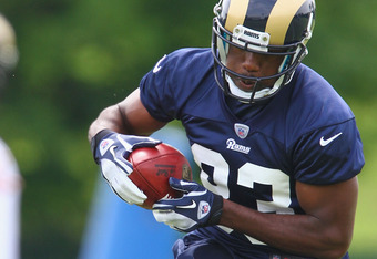ST. LOUIS, MO - MAY 12: Brian Quick #83 of the St. Louis Rams makes a catch during rookie mini camp at the ContinuityX Training Center on May 12, 2012 in St. Louis, Missouri. (Photo by Dilip Vishwanat/Getty Images)