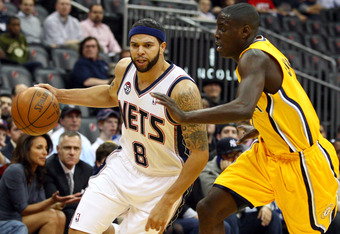 NEWARK, NJ - MARCH 28:  Deron Williams #8 of the New Jersey Nets drives against Darren Collison #2 of the Indiana Pacers at Prudential Center on March 28, 2012 in Newark, New Jersey. NOTE TO USER: User expressly acknowledges and agrees that, by downloadin
