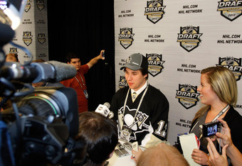 PITTSBURGH, PA - JUNE 22: Derrick Pouliot, eighth overall pick by the Pittsburgh Penguins, speaks to media during Round One of the 2012 NHL Entry Draft at Consol Energy Center on June 22, 2012 in Pittsburgh, Pennsylvania.  (Photo by Justin K. Aller/Getty