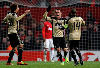 MANCHESTER, ENGLAND - NOVEMBER 22:   Bruno Cesar (C) of SL Benfica celebrates after team mate Pablo Aimar scored their second goal during the UEFA Champions League Group C match between Manchester United and SL Benfica at Old Trafford on November 22, 2011
