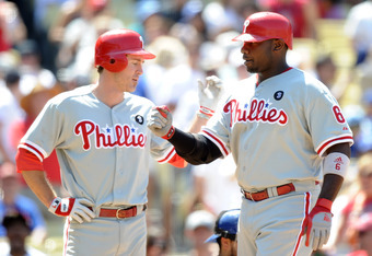 LOS ANGELES, CA - AUGUST 10:  Ryan Howard #6 of the Philadelphia Phillies celebrates with Chase Utley #26  after a two run homerun to take a 9-7 lead over the Los Angeles Dodgers during the seventh inning at Dodger Stadium on August 10, 2011 in Los Angele